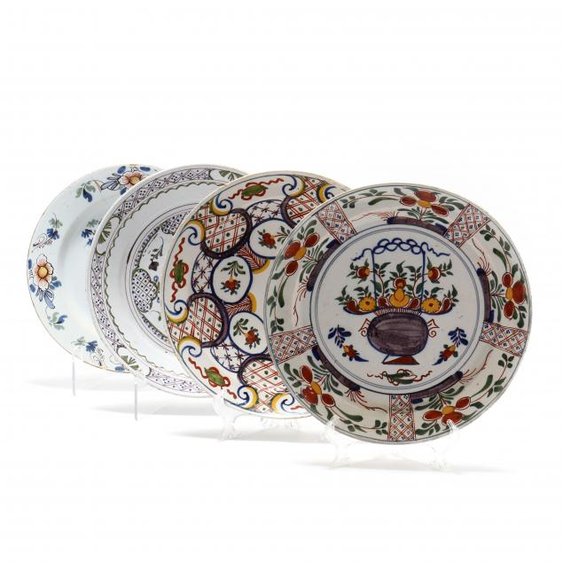a-group-of-four-polychrome-delft-pancake-plates