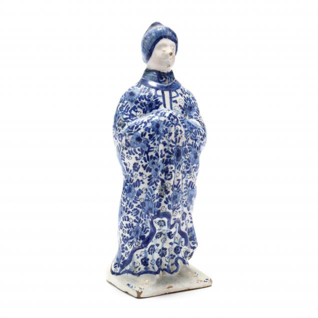 a-blue-and-white-delft-figure-of-a-lady
