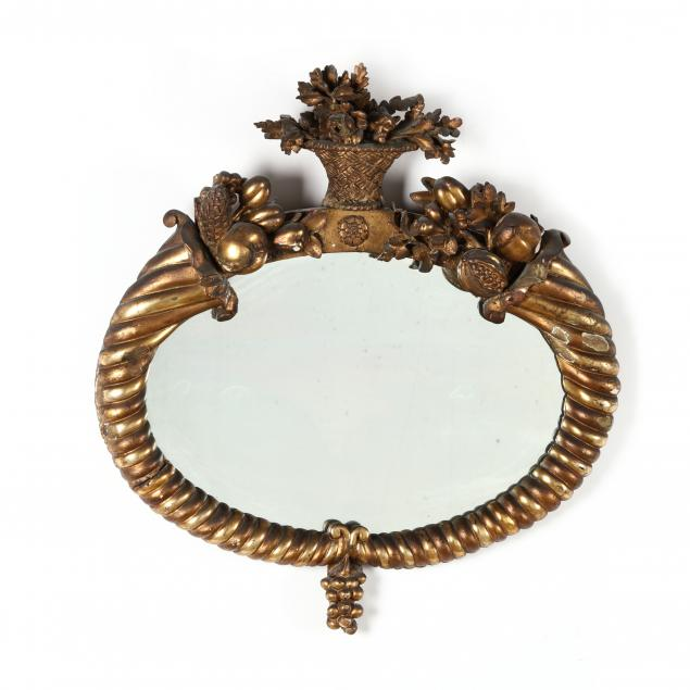 antique-carved-and-gilt-oval-mirror