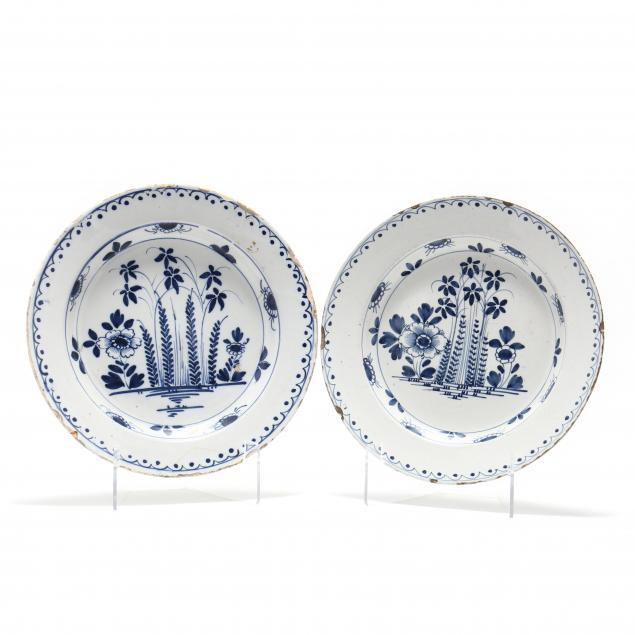 a-pair-of-english-delft-blue-and-white-chargers
