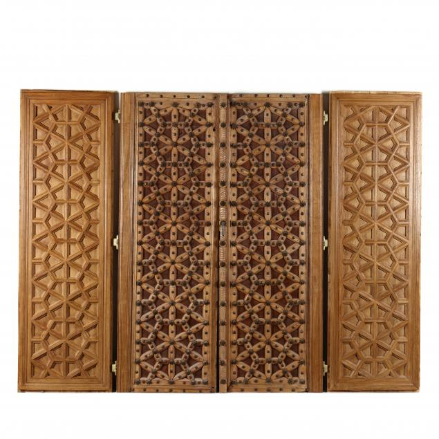 a-pair-of-mediterranean-geometric-wood-doors-and-panels
