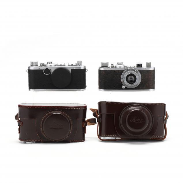 pair-of-vintage-leica-d-r-p-leitz-wetzlar-cameras-one-with-lens