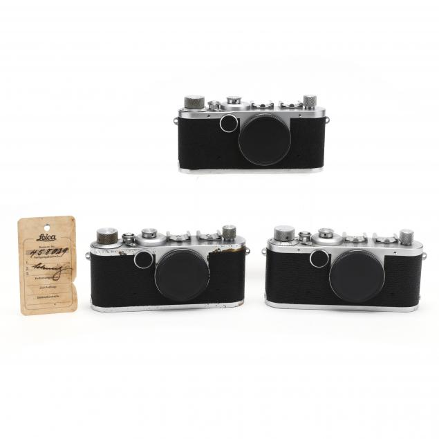 three-vintage-leica-d-r-p-leitz-wetzlar-rangefinder-cameras-each-without-lens