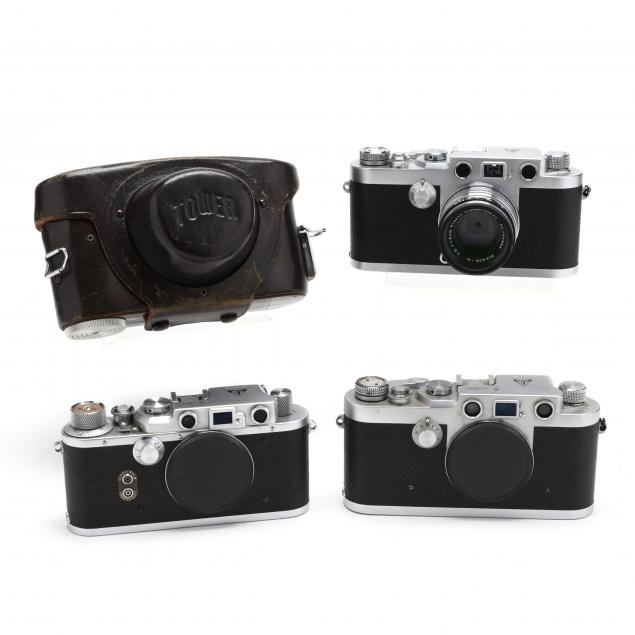 three-vintage-tower-cameras-one-with-nikkor-lens