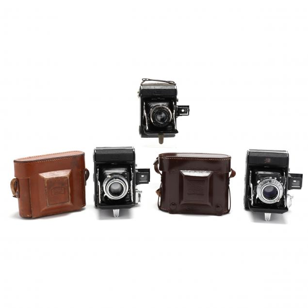 three-vintage-zeiss-ikon-ikonta-521-folding-cameras-two-prewar