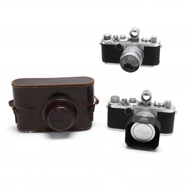 two-vintage-leica-d-r-p-leitz-wetzlar-rangefinder-cameras-with-lenses-and-viewfinders