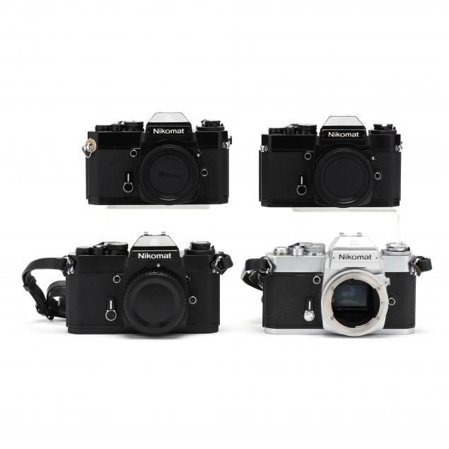 four-nikon-nikomat-el-slr-35mm-film-cameras-all-without-lens