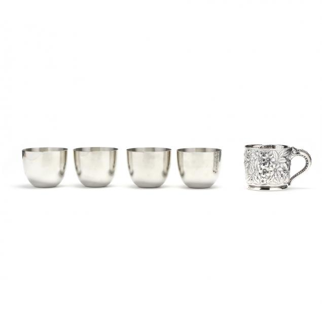 set-of-four-stieff-pewter-jefferson-cups-and-a-repousse-silverplate-cup