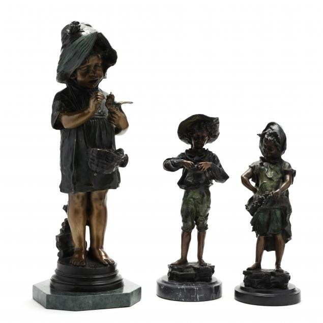 three-bronze-sculptures-of-children