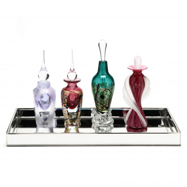 four-art-glass-perfume-bottles-and-mirrored-tray