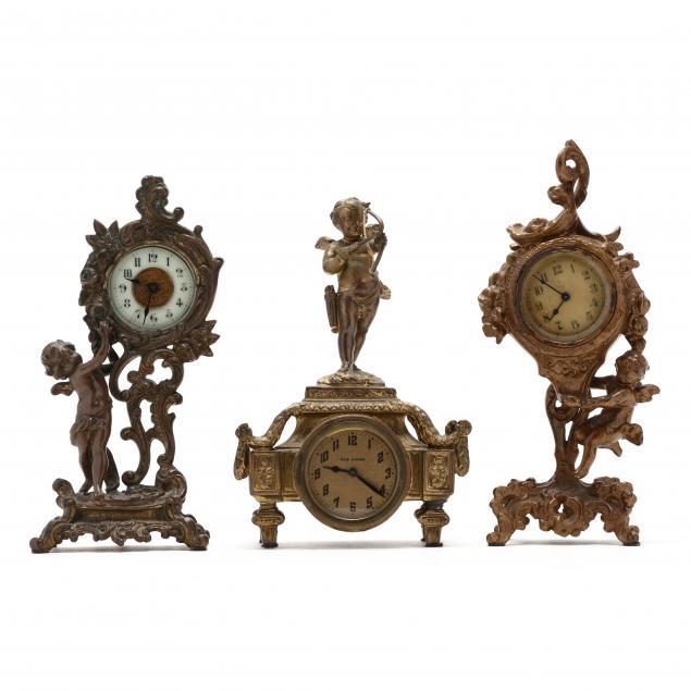 three-antique-figural-desk-clocks