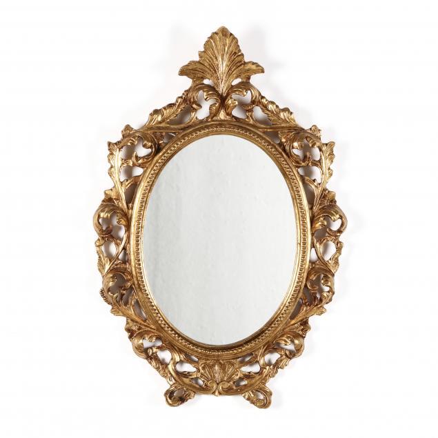 a-diminutive-italian-carved-and-gilt-mirror