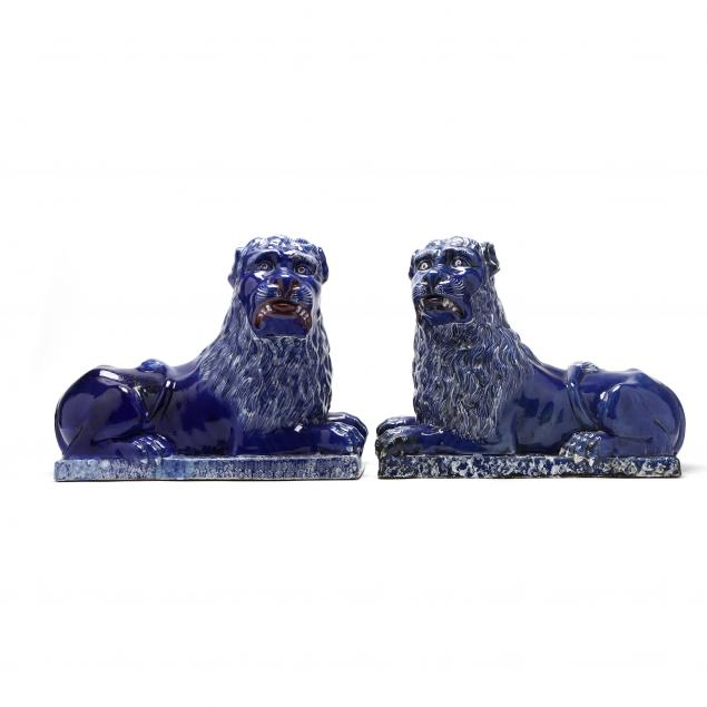 large-and-important-pair-of-faience-guardian-lions
