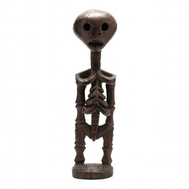 african-carved-wooden-skeleton
