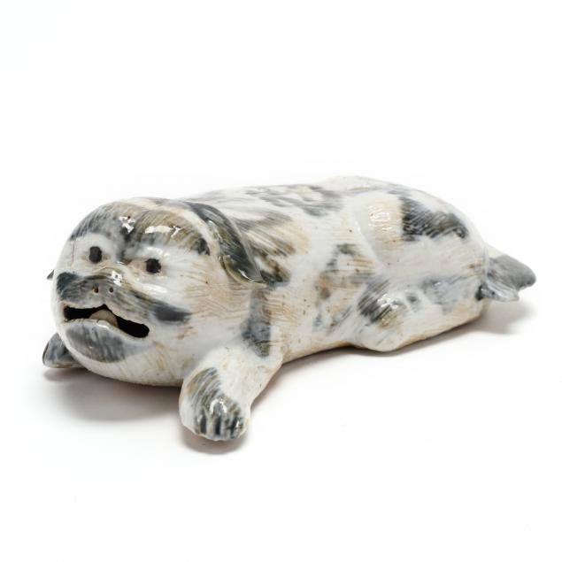 a-chinese-export-style-recumbent-pug-dog