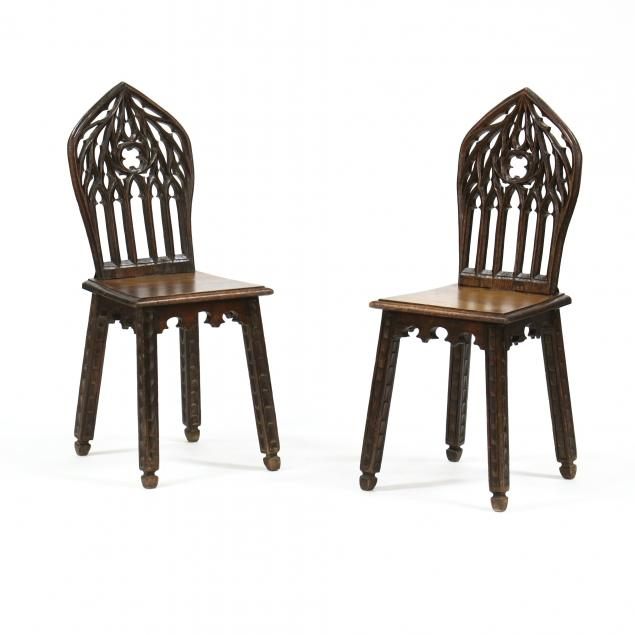 pair-of-gothic-revival-carved-oak-plank-seat-chairs