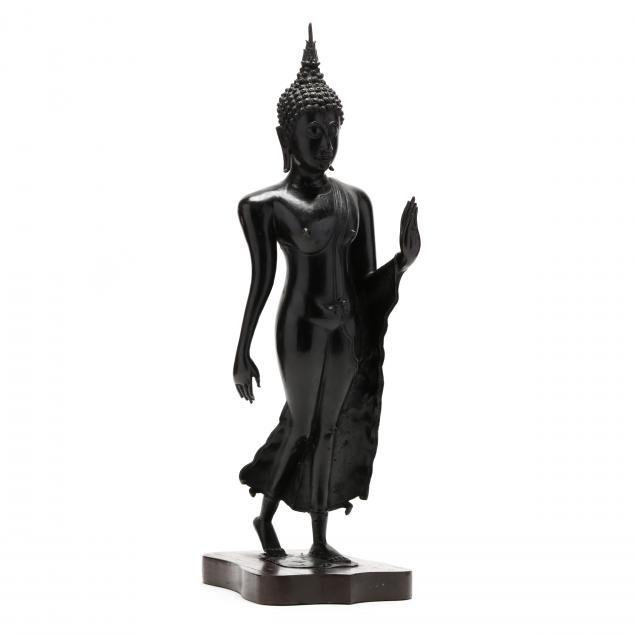 a-sukhothai-bronze-walking-buddha-sculpture