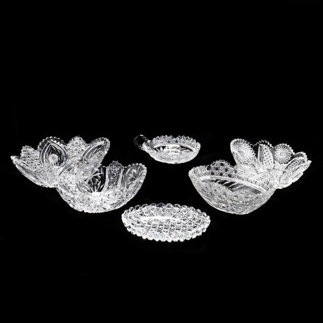 a-grouping-of-six-cut-crystal-pieces