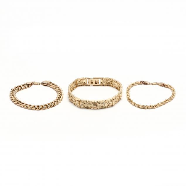 three-gold-bracelets