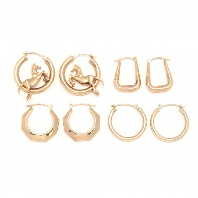 four-pairs-of-yellow-gold-hoop-earrings