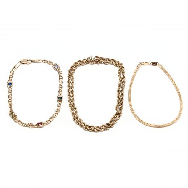 three-yellow-gold-bracelets