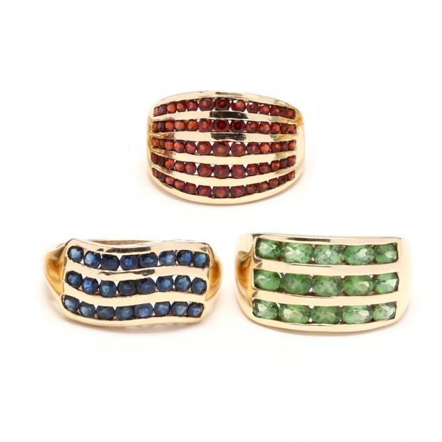 three-gold-and-gem-set-rings