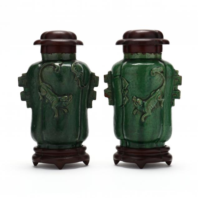 a-pair-of-chinese-green-glazed-jars-with-covers