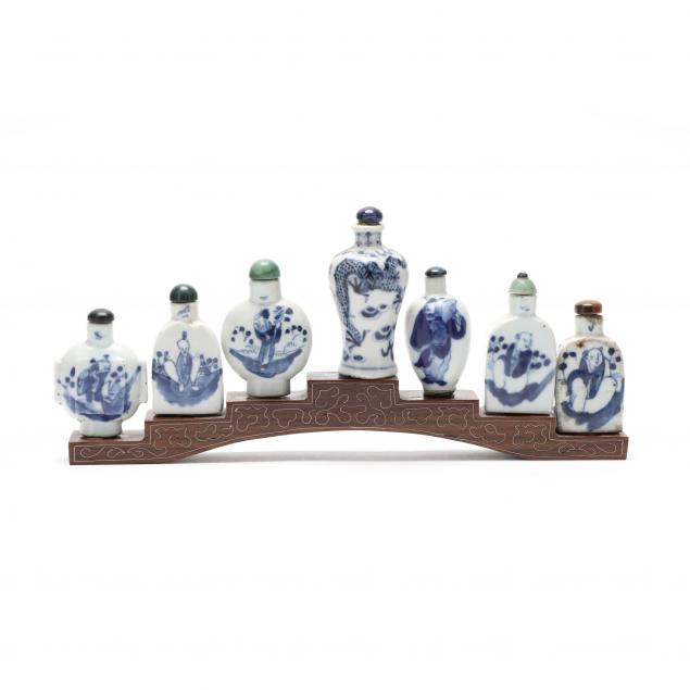 a-group-of-seven-chinese-blue-and-white-porcelain-snuff-bottles