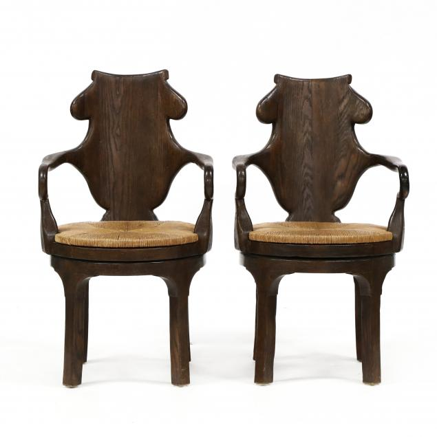 pair-of-english-pub-style-swivel-armchairs